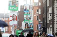 election posters on the street illustrating the focus on electoral politics